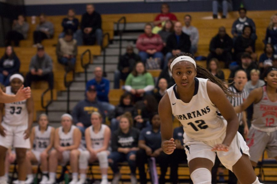 Yaniah+Curry+is+on+the+move%2C+prepping+to+catch+a+pass+from+a+teammate.+This+is+her+fourth+year+on+the+FHC+varsity+team%2C+an+impressive+feat+for+any+player+in+any+sport%2C+and+will+be+attending+the+University+of+Toledo+in+Ohio+on+a+basketball+scholarship.+