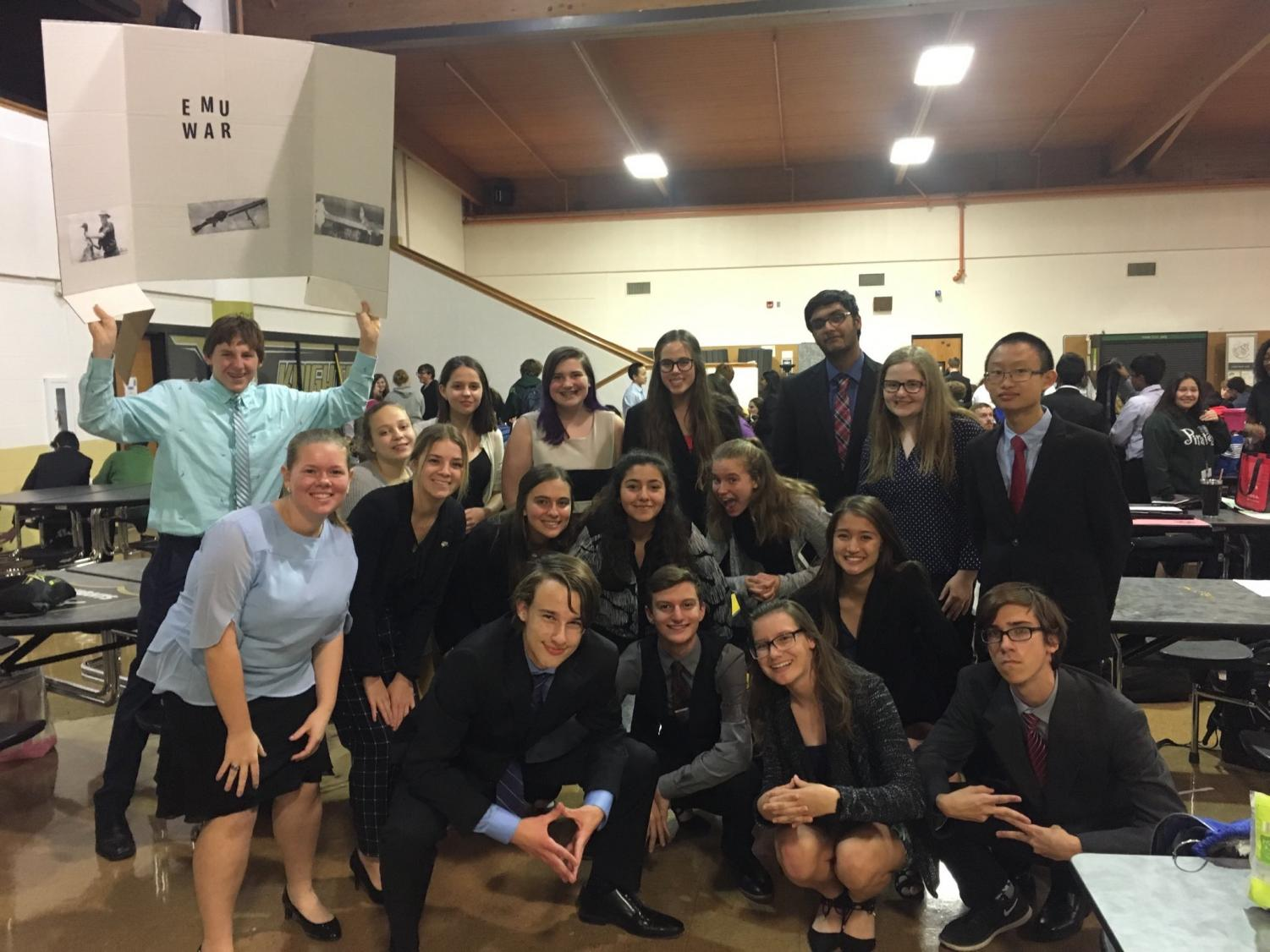 The speech and Debate team poses for pictures after a tournament