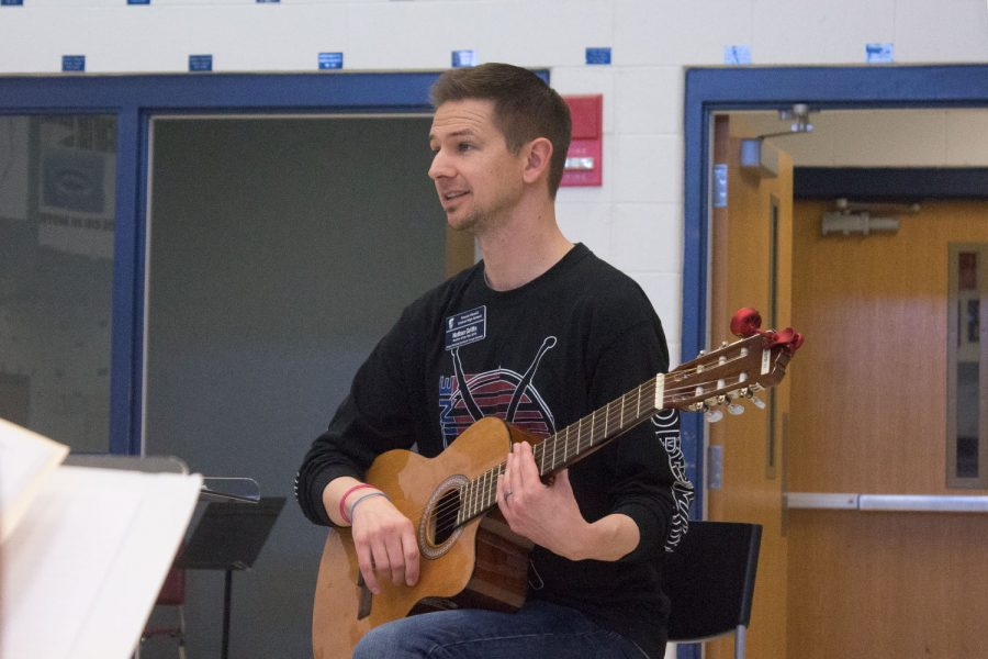 Mr. Griffin teaching his Music Appreciation more basics about a guitar