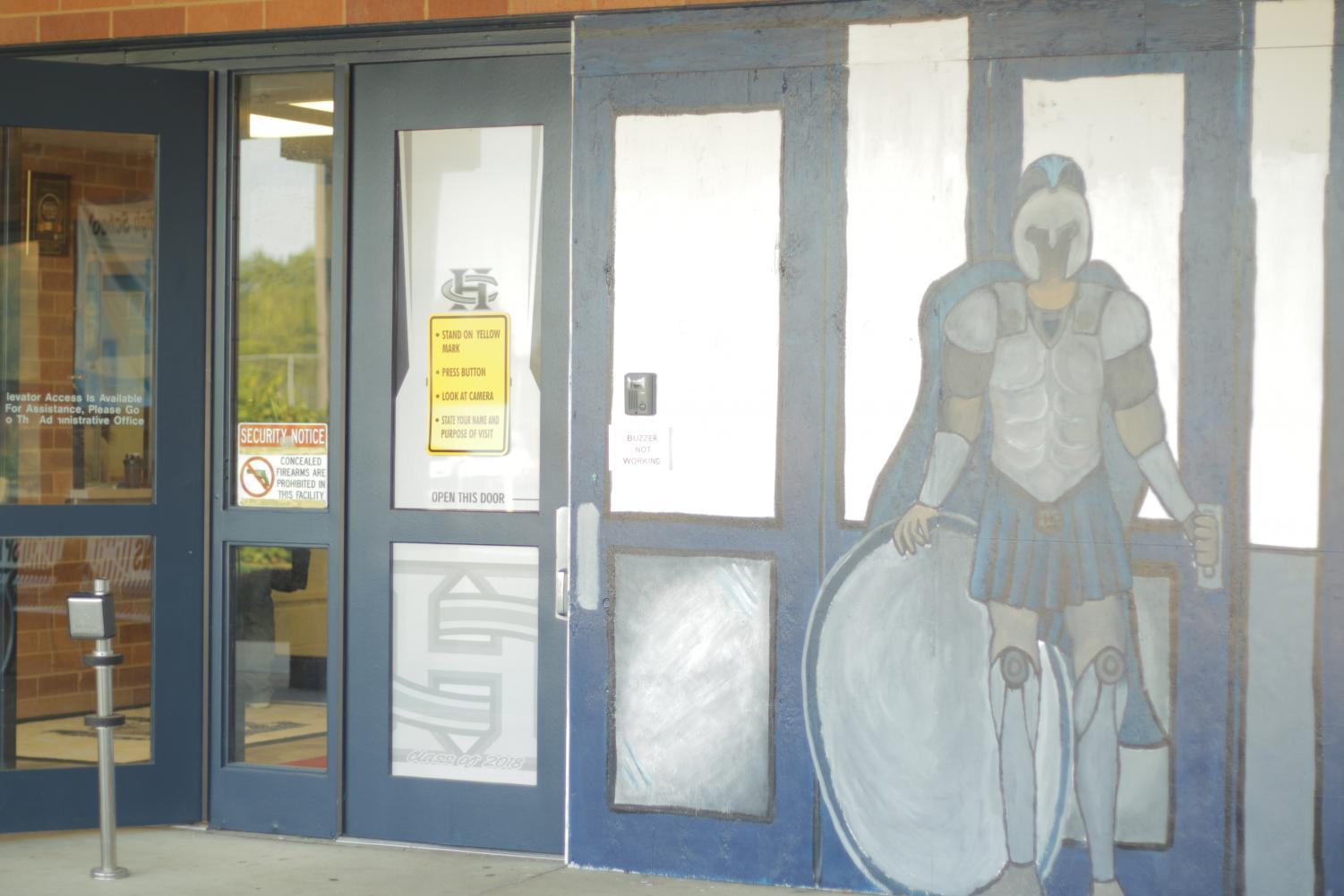 The mural of the Spartan on the front entrance to the school.
