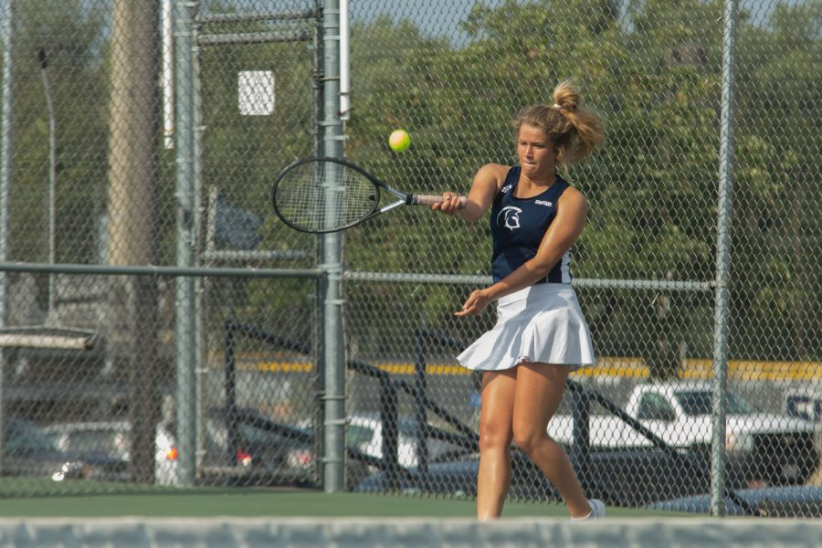 Mackenzie Jones faces FHN during their first meet. FHC won this meet 7-2.