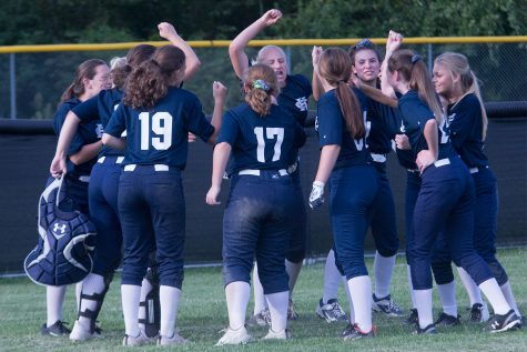The girls softball team celebrates at the end of another victory. They had a very successful first week of the season, with 4-1 win streak.