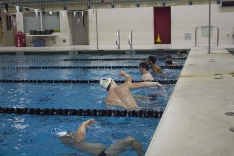 The boys swim a specific amount of laps and yardage every practice together as a team.