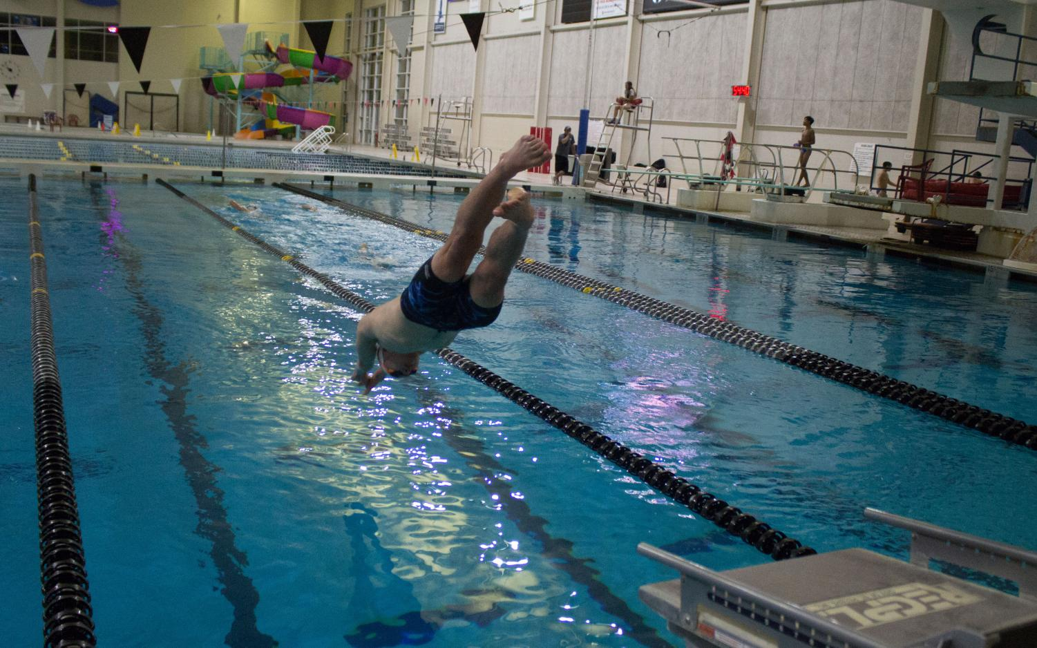 A member of the team rives into the water