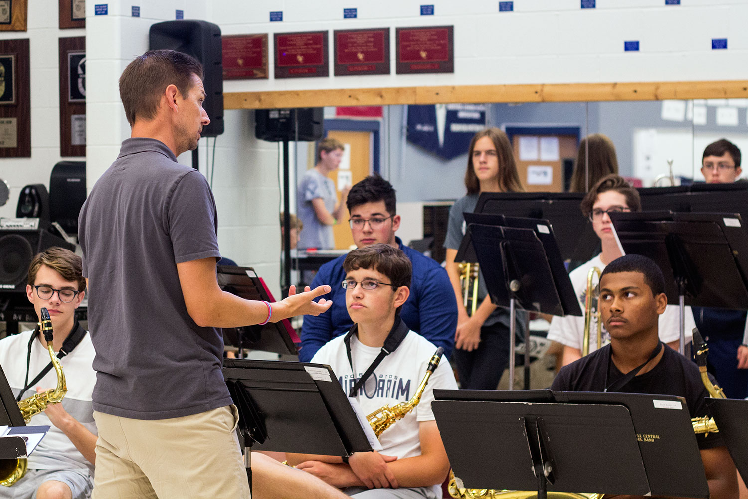 Mr. Nathan Griffin speaks with members of one of the school bands.  The Jazz Band is in search of a bass player to round out its sound.