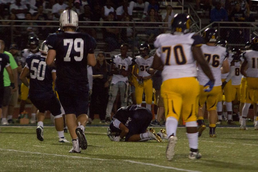 An on-field injury tests senior Kyle Roland's will to continue on.
