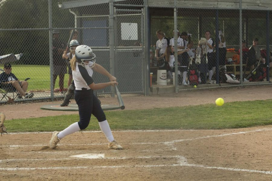 A varsity Spartan hits a ball at the game against FWZ. The Spartans won 3-2