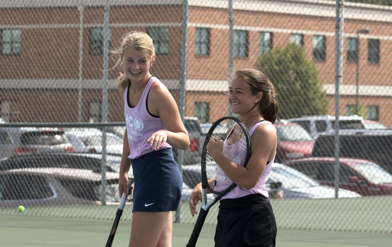 Senior Inge Petrie and sophomore McKenna Lenhardt celebrate after winning a point at the FHC Doubles Tournament on Friday.