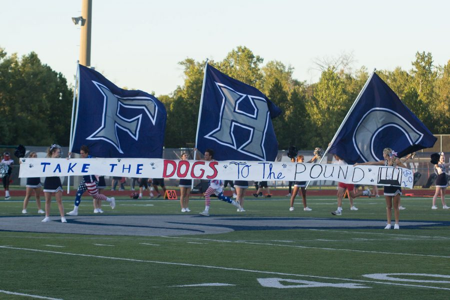 Before the varsity football team's home opener, the student supporters displayed a banner that read