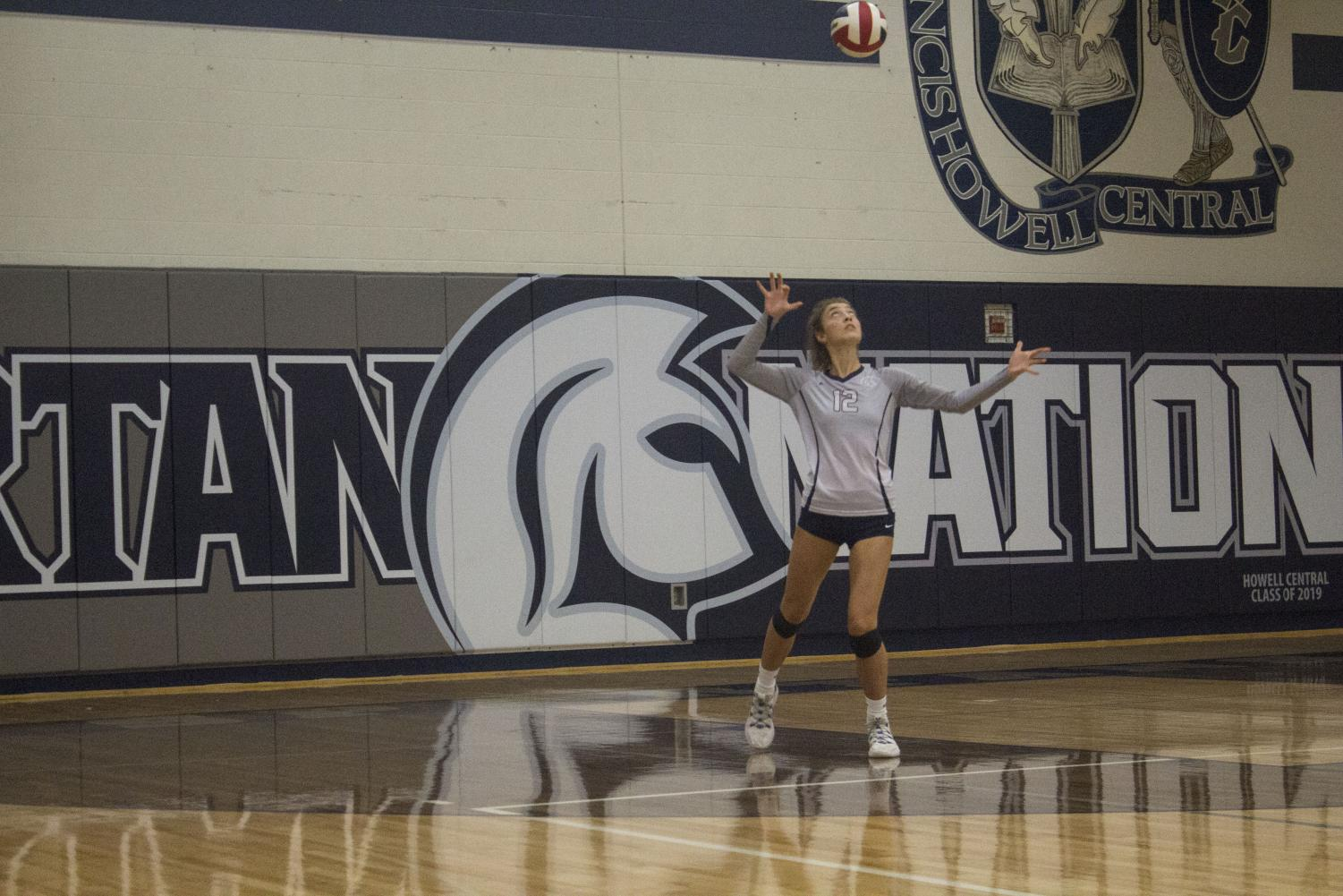 Senior Olivia Green serves the ball during the Spartan victory on Sept. 5. This past weekend the girls varsity team had a tournament in Washington.