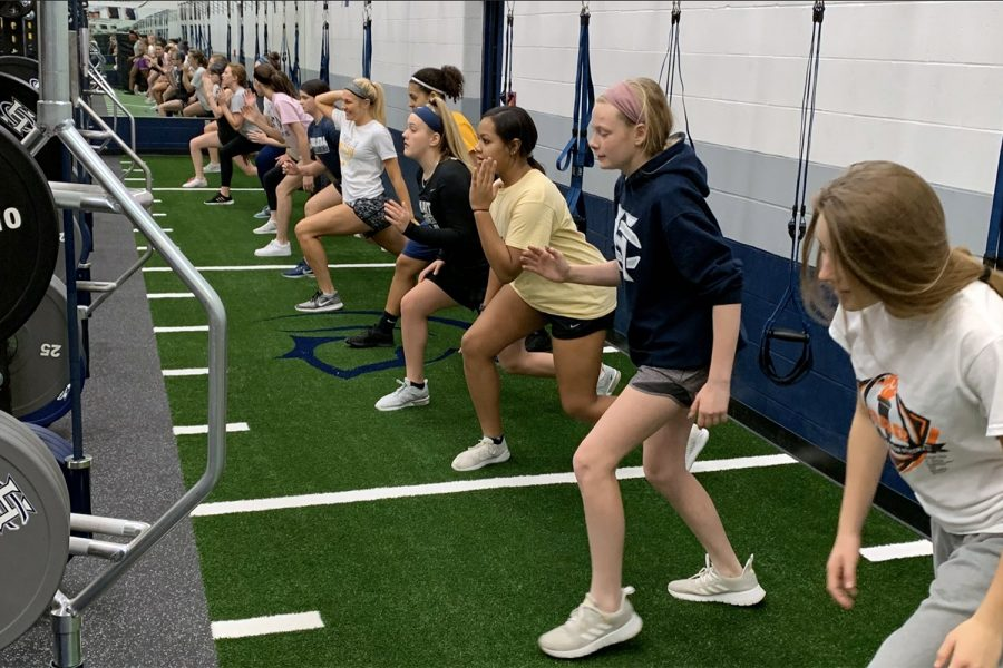 Members+of+the+girls+basketball+program+work+out+in+the+new+workout+facility+during+an+early+morning+workout.+The+team+was+forced+to+move+workouts+while+the+center+was+being+created+but+didn%27t+see+a+decline+in+attendance%2C+despite+cramped+conditions+in+the+temporary+workout+site.