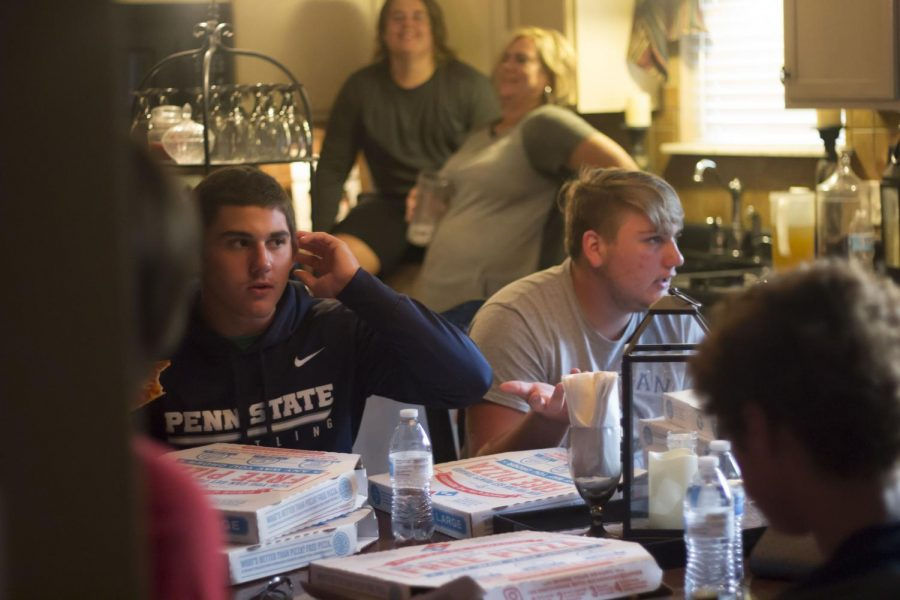 Alex Vogel and Dillon Davis eat with the other FCA members, enjoying their down time with friends after practice.
