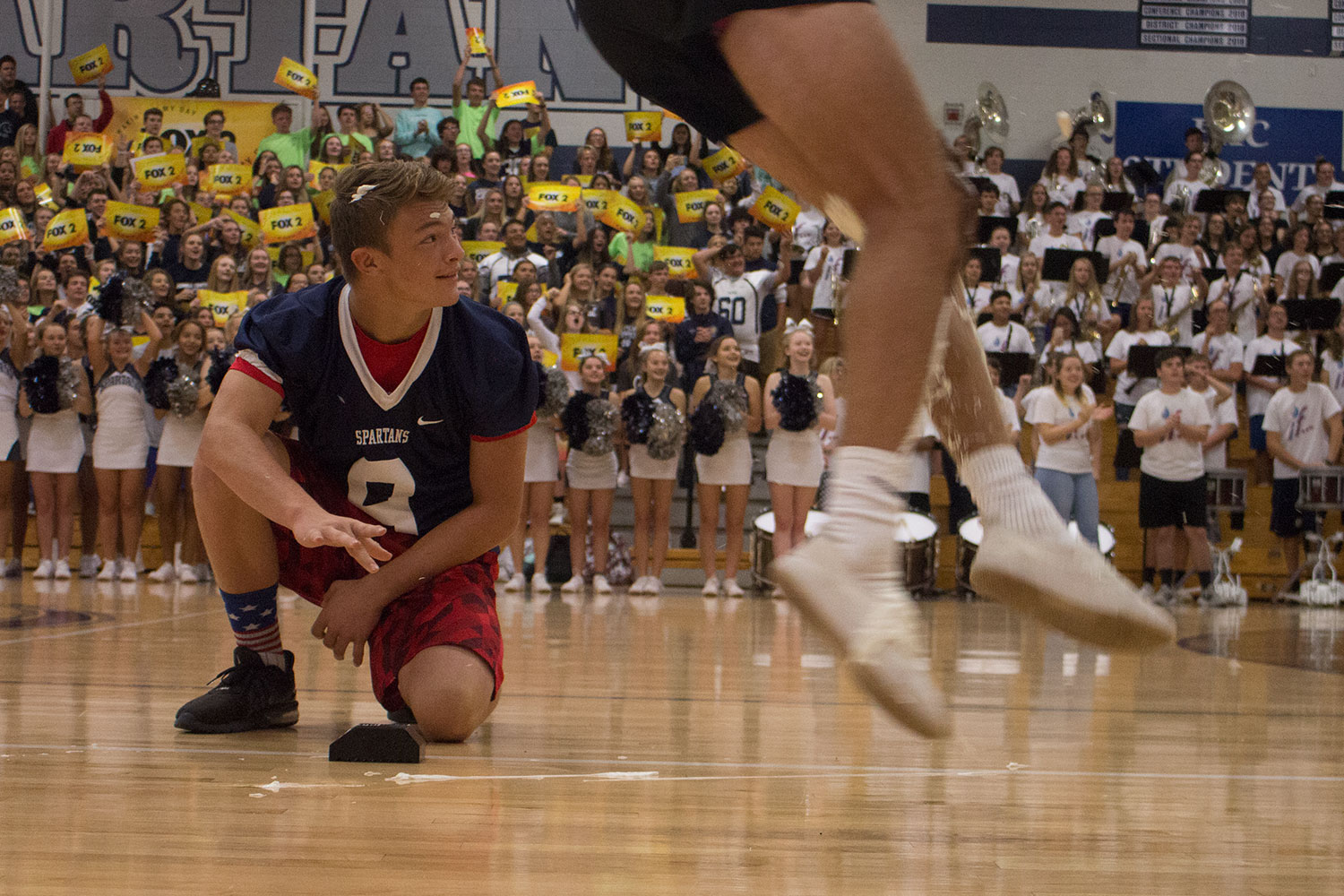 Freshman, Aidan Hernandez watches as Senior Sam Newton hurdles the ball into the arms of the FHC coaches. On friday the 13th of september the student of Francis Howell Central gathered in the gymnasium to support their school. Fox 2 news made an appearance at the high schools pep rally,and all the students couldn't have been more excited.