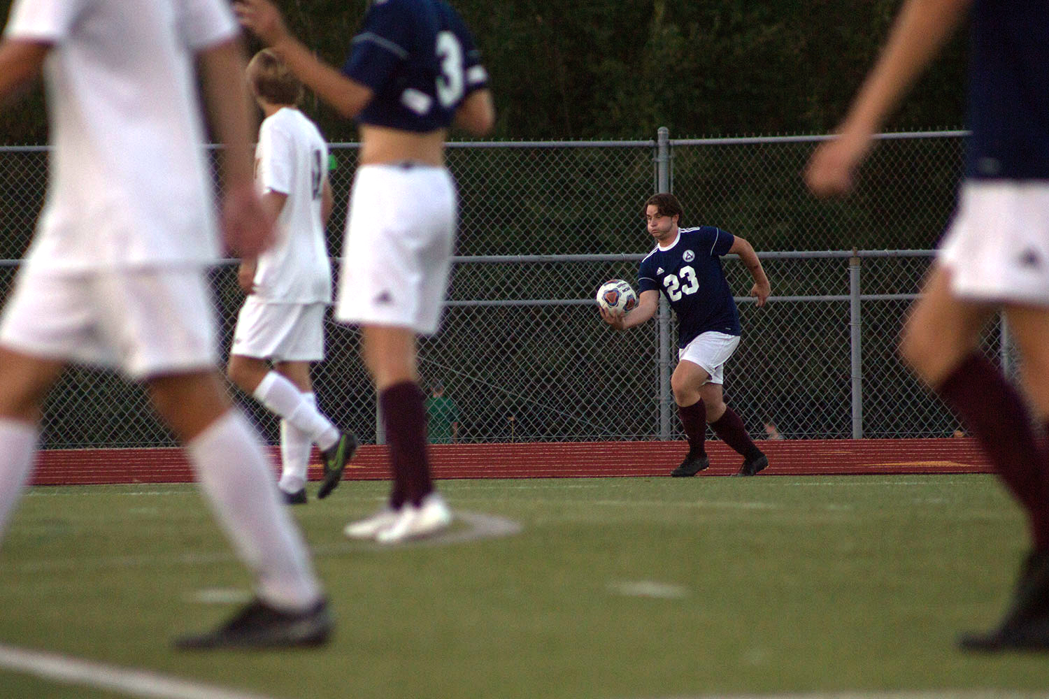 Junior Adam Donnell prepares to take a throw in at the FHC vs. Vianney game. Donnell is one of two players on the team that has a long throw which is an advantage to the team.
