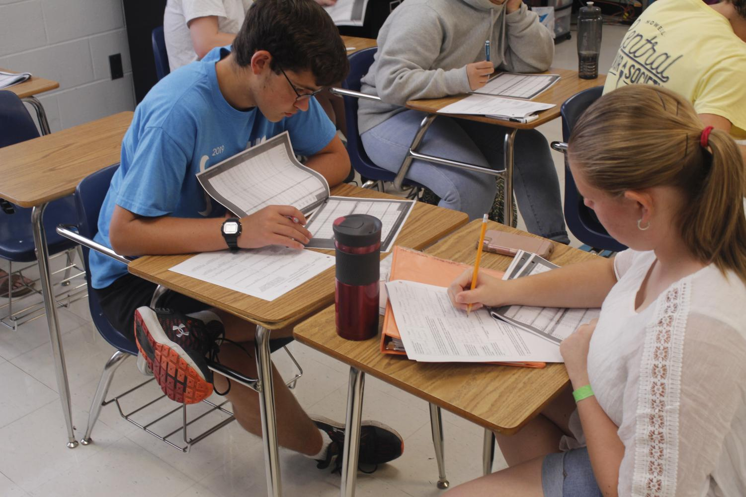 HARD AT WORK - Senior Kyle Bryan focuses and works on homework in AP Human Geography, a college level course similar to the Calculus 3 class he is enrolled in at SCC