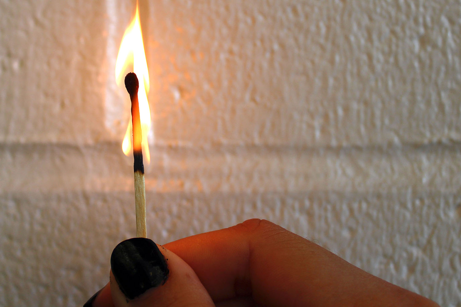 A match slowly loses it's fire. This is symbolic of the way gifted student's ambition slowly slips away over the years.