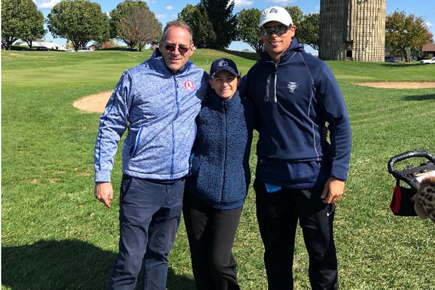 Gabrielle Berger with Coaches Paul Otto (left) and Johnathan Clark (right) at state. Coach Otto is the head coach and both helped Berger all season.