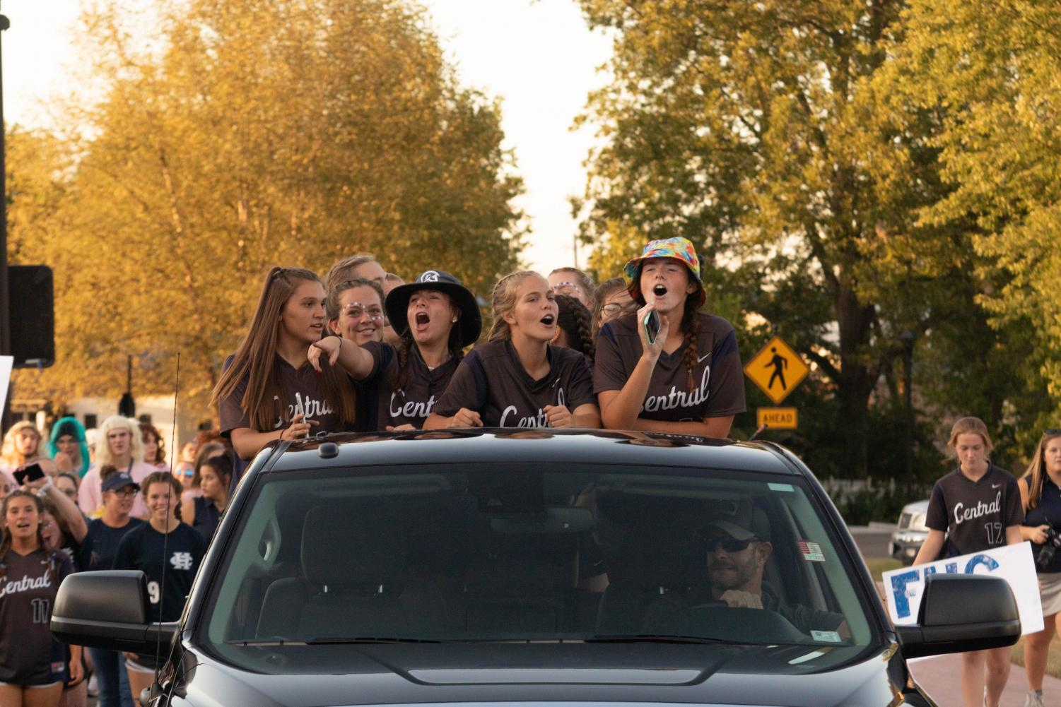 """The entire Softball Program is pictured singing """"Party In The USA"""" by Miley Cyrus together on the back of Sophomore Josie Bezzole's dad's truck."""