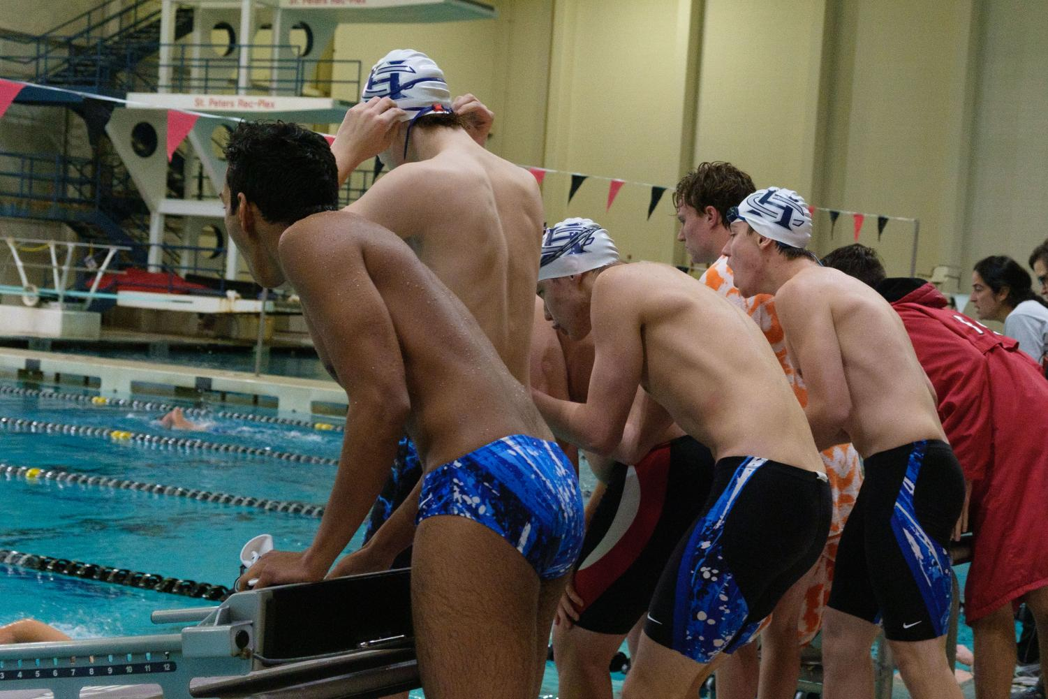 GOING ALL THE WAY - FHC Swimmers cheer on their fellow teammate as they swim their event. The team all encourages each other to swim their best, regardless of the outcome of the event.