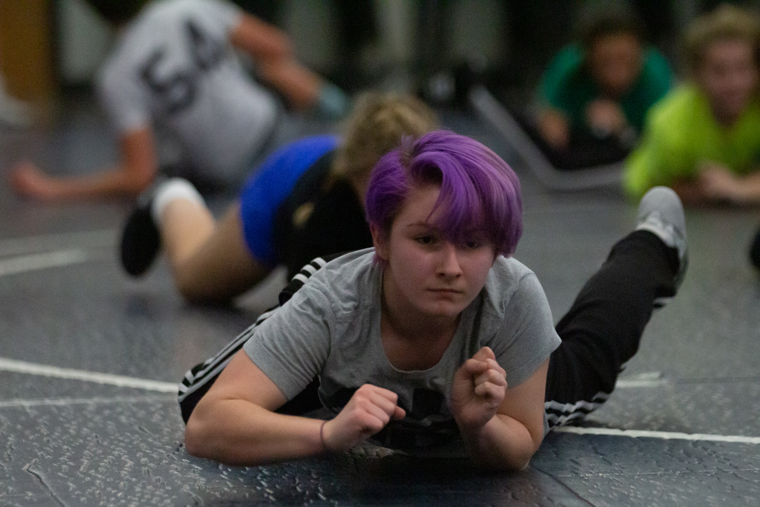 Female wrestlers practice as they prepare for their first match on Dec. 12