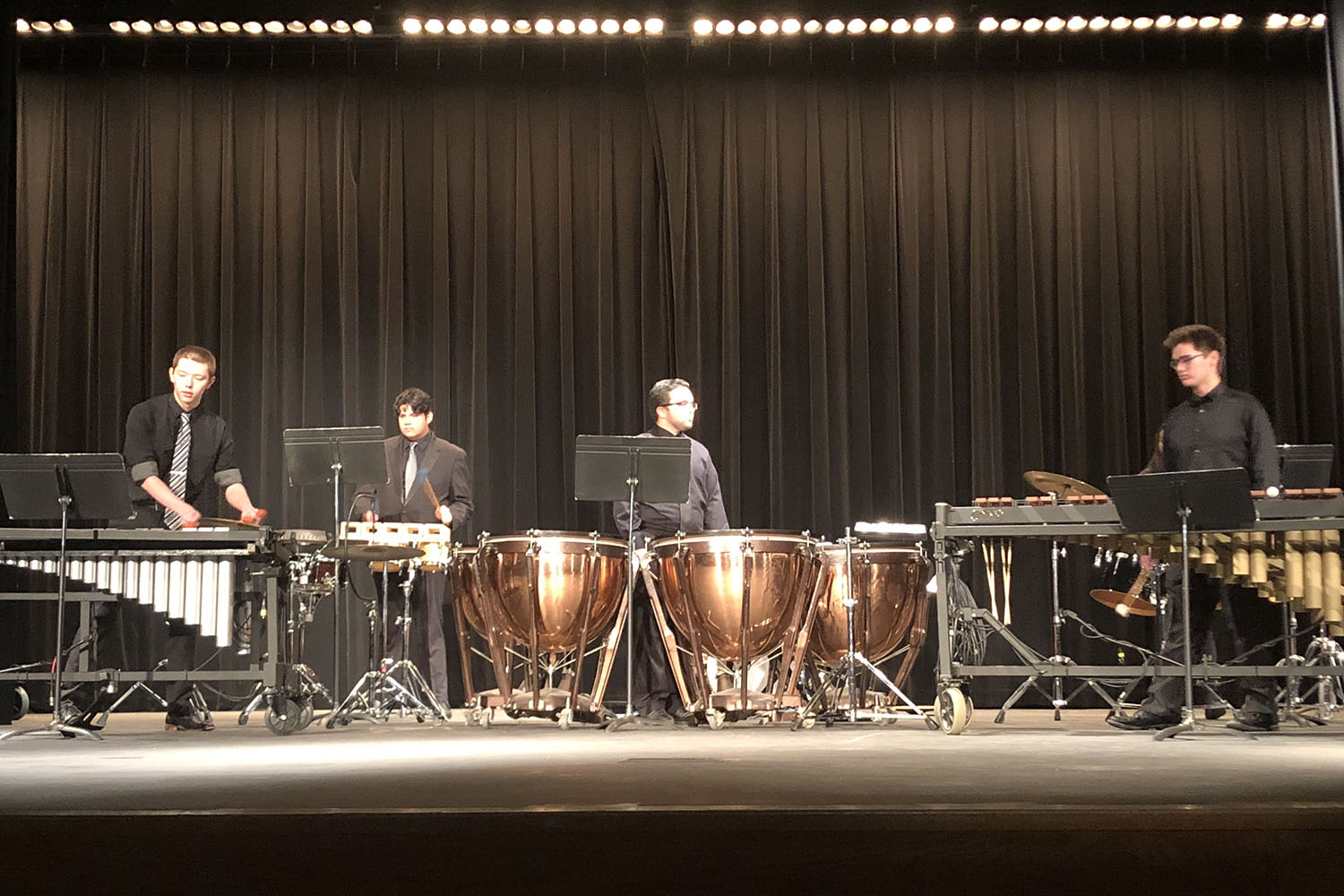 PERCUSSION: The last wind ensemble group to perform was a percussion feature. The members of this group are Chris Bissett, Sam Bippen, Connor Banden, Alex LaBanca, and Emma Smallen.