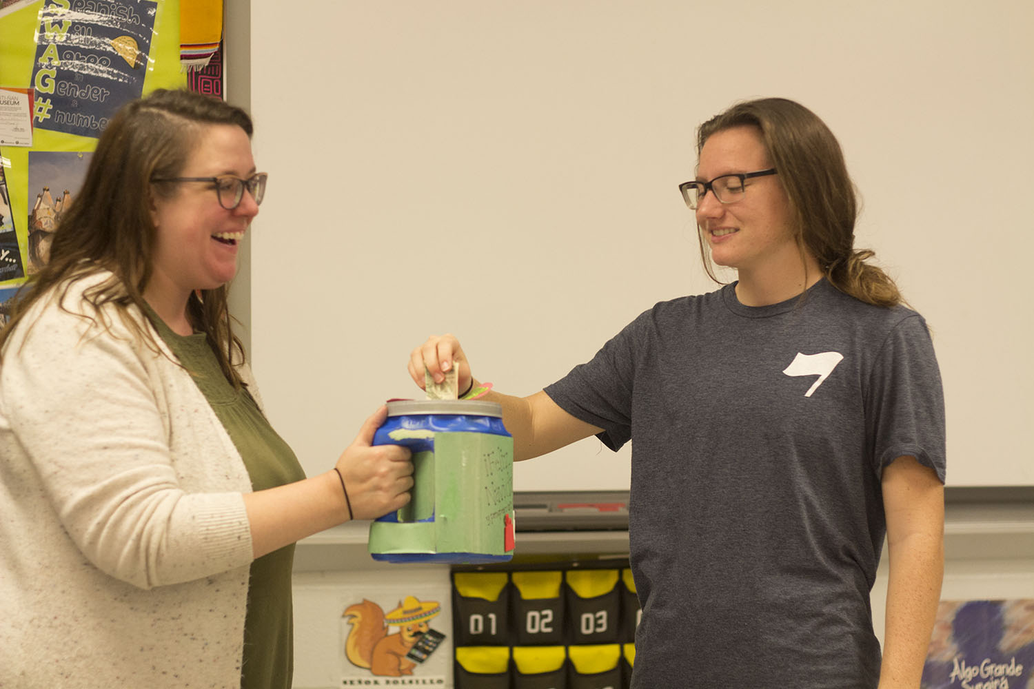 Mrs Crain receives money from junior Rhyen Standridge as a part of the Winter Love Collection through the language department. The money raised was used for making the holiday season enjoyable for students.