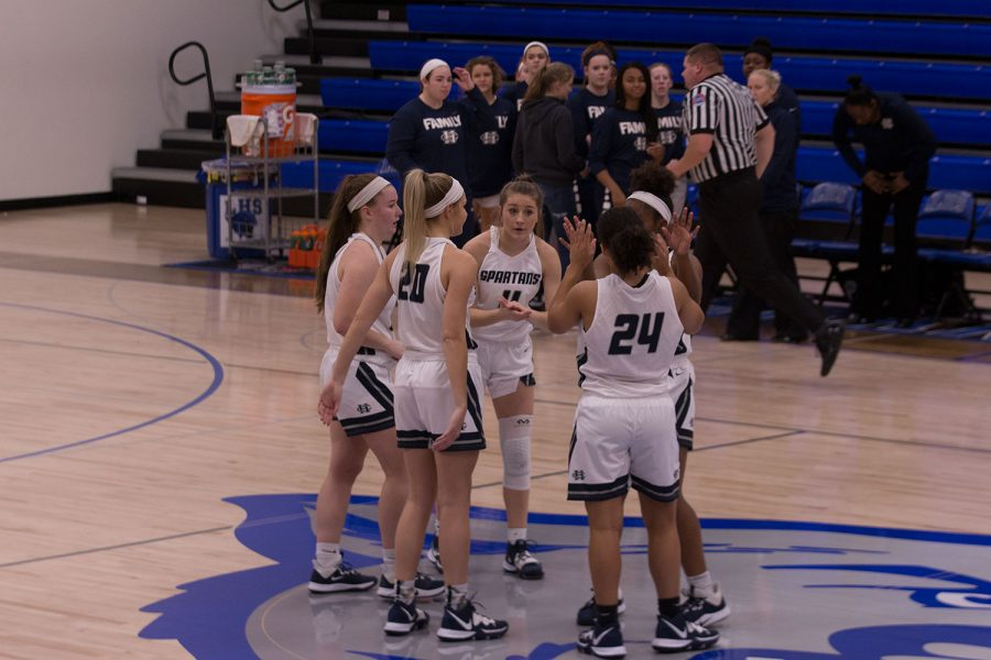 The+team+huddled+together+during+time+out+to+motivate+and+encourage+each+other.+Francis+Howell+Central%27s+girls+basketball+team+has+officially+beaten+the+school+record+of+15+consecutive+wins+as+they+come+out+on+top+to+get+their+16th+win.