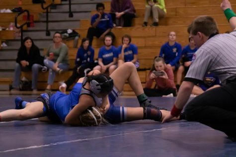 Senior and only returning member of the girls wrestling team, Sophia Tran, holds her opponent down in a match against Seckman High School. Constantly facing different opponents has allowed tran to develop the skills that allowed her to qualify for state alongside freshman Sophia Miller.