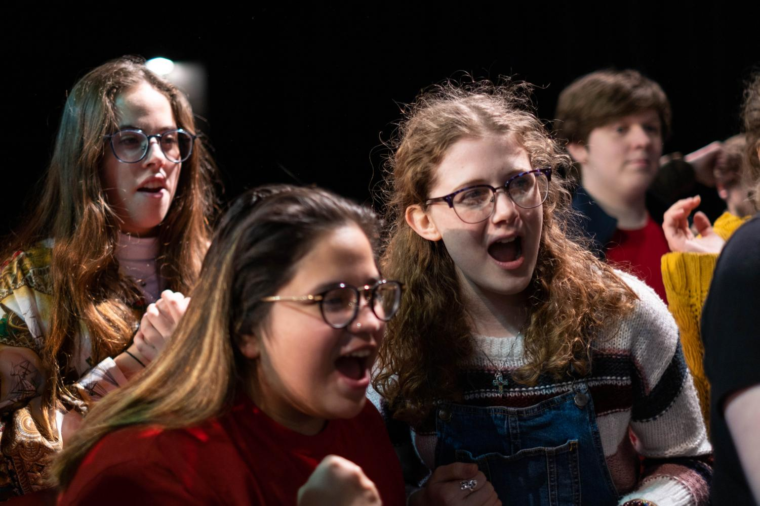 Zoe Michals, Krystal Arias, and Rachel Vrazel gaze at a distant point in awe. Theatre is the common denominator of each of these bright individuals.
