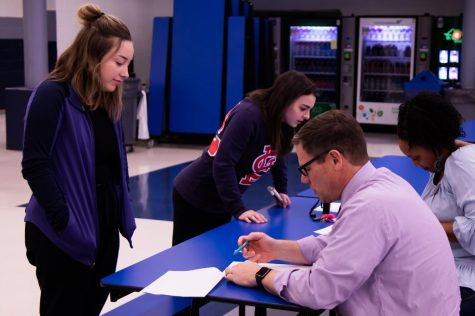 On Wednesday, March 11, Assistant Principal Dave Stofer takes a student