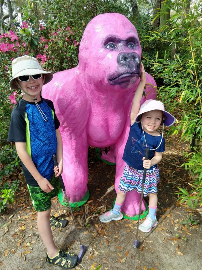 Mrs.+Katie+Mastorakos%27+children+stand+beside+a+pink+gorilla+at+a+mini-golf+in+Gulf+Shores%2C+Ala.+