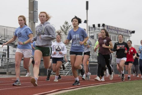 The girls soccer team runs laps around the track as part of their after school training. The team began training for the upcoming season back in November.