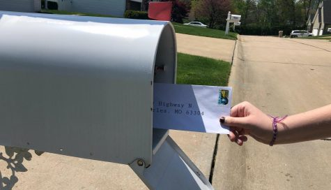 Zoe Michals mailing off a letter to her pen pal.