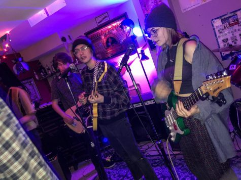 Joshua Hezel, Zach Daubert, Margaret Wilkerson, and the rest of their band music-make in harmony on the night of their Red Cross fundraiser.