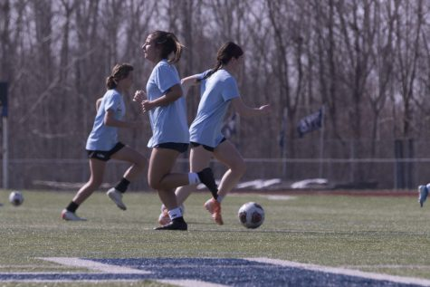 Seniors Kierigan McEvoy and Jay Viola, along with sophomore Jordyn Bailey, practice for girls soccer, one of the 22 MSHSAA sponsored sports offered at FHC. This is one of the 15 sports that make cuts to their programs: that