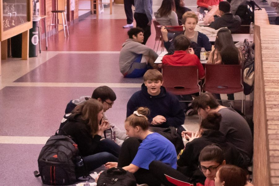 Students at Olathe East High School, located just outside Kansas City, Mo., congregate during their expanded lunch time. Students, teachers and administrators visited Olathe East in late February to observe and ask questions of people there about the power lunch they have instituted the last couple years.