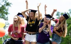 A group of seniors cheer for their classmates after they had finished the senior parade on May 28.