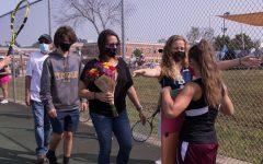 Erin Reitz, Captain, hugs her teammate during an emotional senior night ceremony