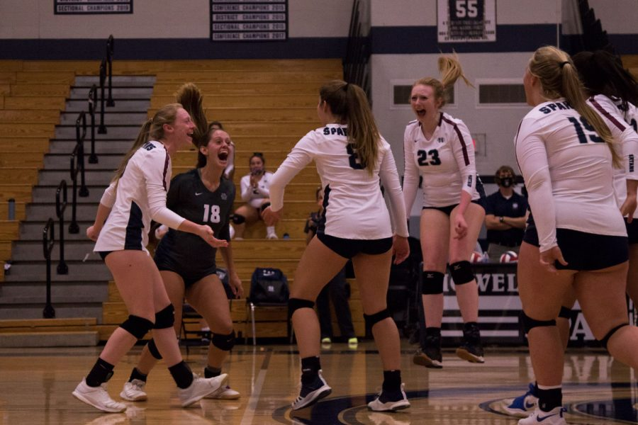 Senior Emma Hultz goes to celebrate a point with her teammates. The team makes sure to keep a positive attitude after each point to encourage perseverance despite tough competition.