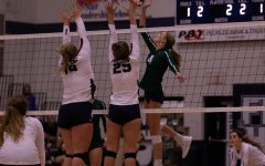Kennedy Eggering and Kirsten Steinmeyer block Timberlands hit.