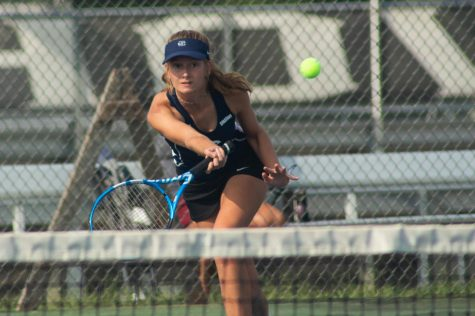 Junior Chloe Schwab, hitting the ball.