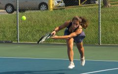 McKenna Lenhardt, Junior, after hitting the ball.