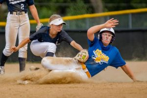 Emily Chadwick, Junior, tagging her Howell opponent out at second base.