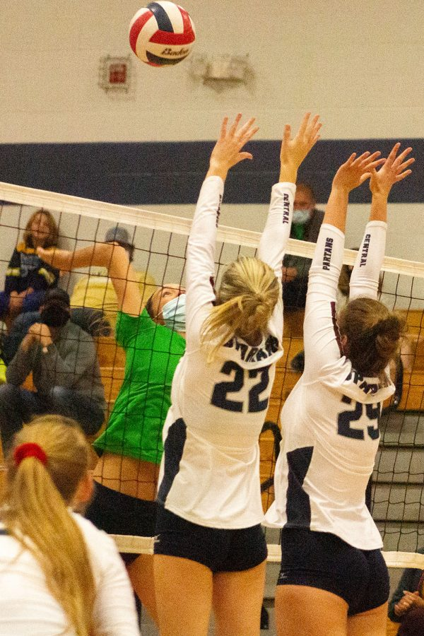 Kristen Steinmeyer and Kennedy Lamb try to stop Marquette from scoring.