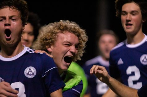 Junior Tommy Hubbard and Senior captain Carter Redford celebrate the final goal victory.