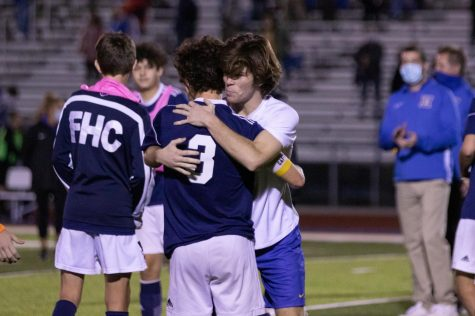 Captain Carter Redford hugs an opposing player after the district finals game.