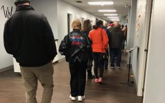 Voters line up in Missouri to fill out election ballots. As elections brought about a rise in tension, people were eager to express their opinions and rights to voting.