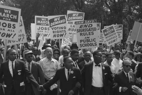 Civil Rights activist Martin Luther King Jr. leads a group of protesters at a rally in the 1960's. Like the Civil Rights movement, current protests have become a popular way to show support for racial equality