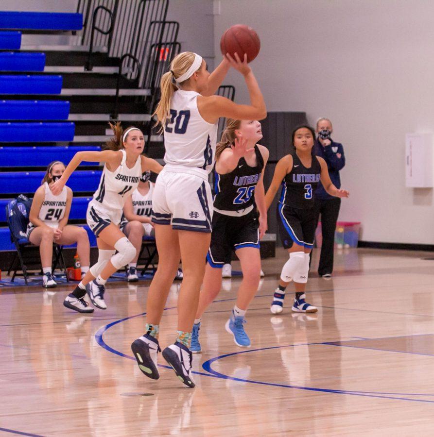 Senior Sofia Tweedie shoots a three-pointer.