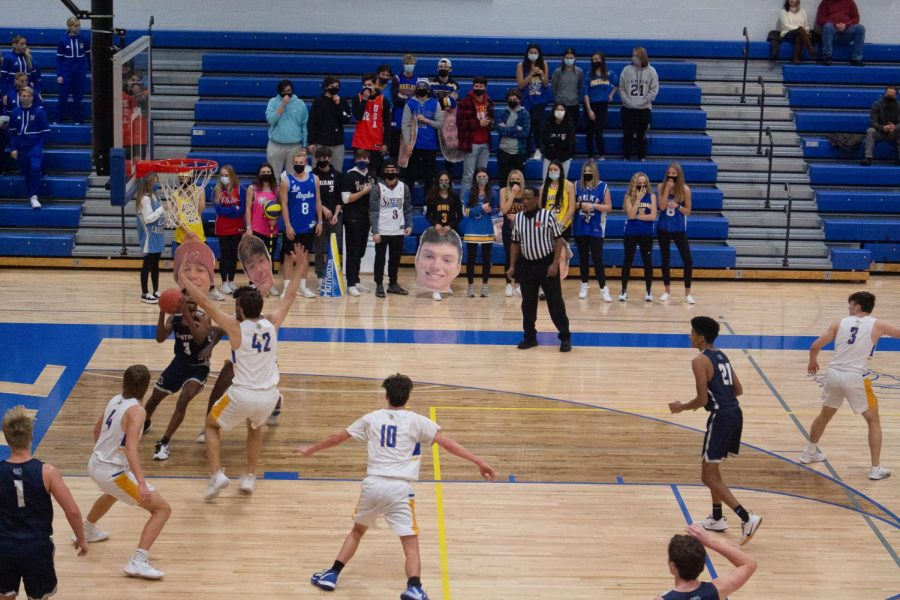 Senior Tevin Tipton about to shoot during the Dec. 18 game against Howell High. The Spartans lost this game 50-48.